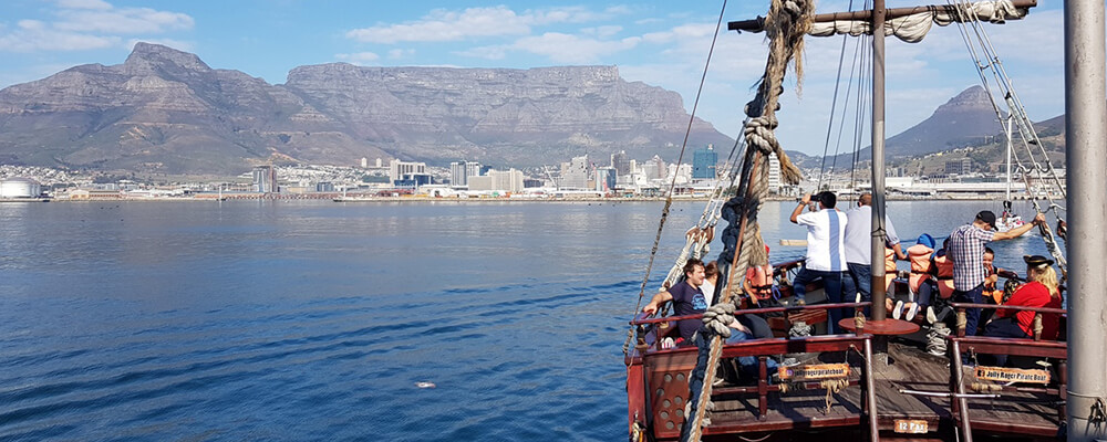 Jolly Roger Pirate Ship with Table Mountain in the vista